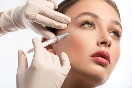 Cute girl receiving hyaluronic acid treatment