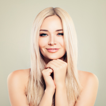Perfect Female Face. Beautiful Model Woman with Healthy Skin and Blonde Hair. Spa Beauty, Facial Treatment and Cosmetology Concept